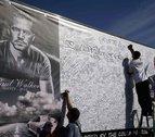 Two weeks after his death, Paul Walker is buried