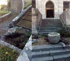 Rompen una pila bautismal y una jardinera de piedra en la iglesia de Leitza