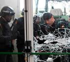 Diecinueve policías y catorce guardias civiles heridos en Cataluña