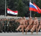 Putin visita Siria y ordena la retirada de las tropas rusas