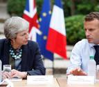 May confía en llegar a un acuerdo con la UE pese a la advertencia de su ministro