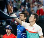 Djokovic aprovecha la retirada de Nishikori y buscará la final contra Pouille