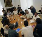 PSN, Geroa Bai, Podemos e IE negocian ya en siete mesas un acuerdo de Gobierno