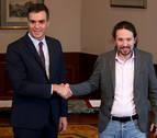 Sánchez e Iglesias firman un preacuerdo para un Gobierno de coalición