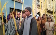 Imagen del grupo de niños con palmas, que acompaña al paso Entrada en Jerusalén.