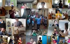 Foto del vídeo multipantalla, los chicos y chicas de Iganga cantan acompañados por los alumnos de trompeta de Barañáin.