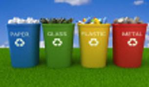 Unos contenedores de colores para reciclar.