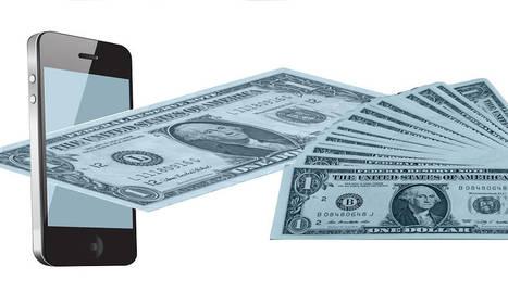 foto de dinero saliendo de un móvil