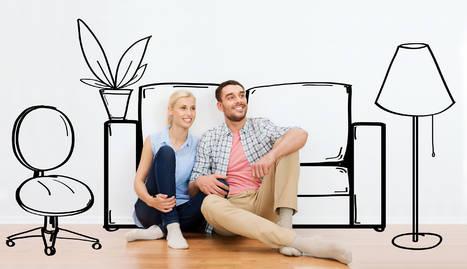 Foto de una pareja imaginando su primera vivienda.