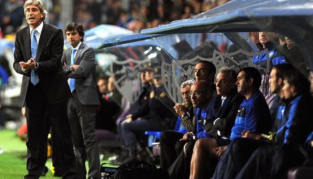 Imágenes del encuentro entre Osasuna y Málaga, disputado este domingo en el estadio de la Rosaleda.
