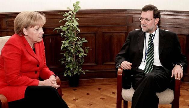 Rajoy y Merkel, en 2010