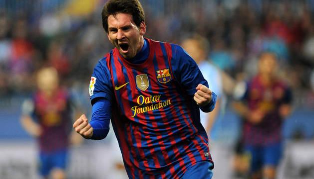 Messi celebra uno de sus goles ante el Málaga