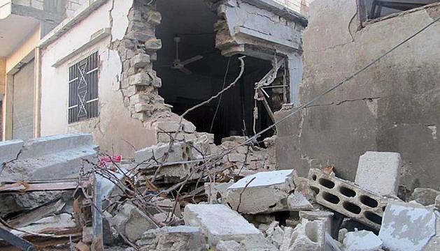 Escombros de una vivienda en el barrio de Bab Amr, en Homs (Siria).