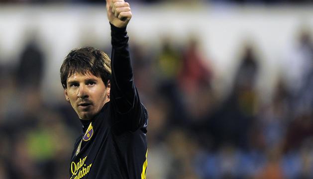 Messi celebra uno de sus dos goles ante el Zaragoza