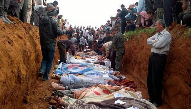 En una fosa comun, en Siria