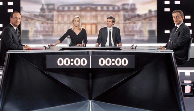 Hollande y Sarkozy, antes del debate televisivo.