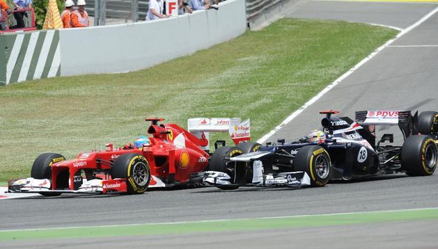 Alonso y Maldonado, durante el G.P. de Formula Uno en Montmeló