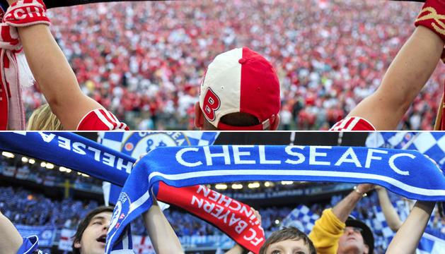Un aficionado del Bayern (arriba) y un joven seguidor del Chelsea (abajo) animan a sus respectivos equipos durante la final de la Liga de Campeones en el Allianz Arena de Múnich