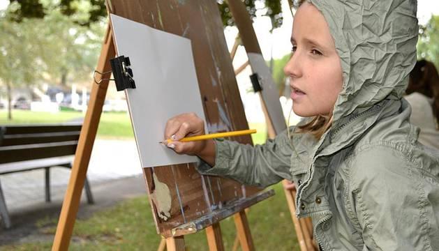 Varias imágenes del Concurso de Jóvenes de mayores de cinco años, organizado este sábado por la red Civivox en la Ciudadela, ha sido aplazado para el 1 de septiembre por la lluvia.