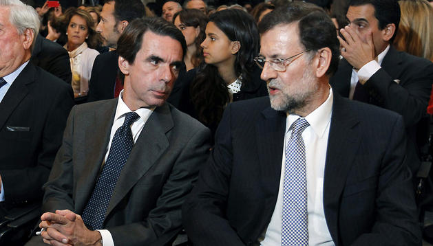 El presidente del Ejecutivo Mariano Rajoy, y el presidente de la Fundación FAES y expresidente del Gobierno José María Aznar