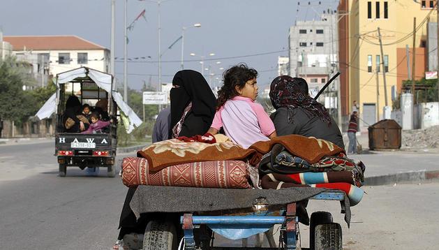 Las familias palestinas vuelven a sus casas en Gaza