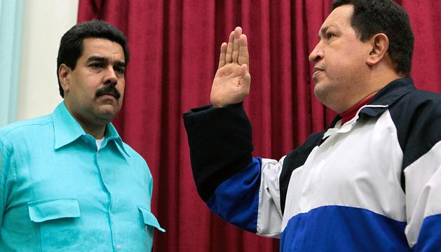 Imagen del pasado 10 de diciembre en la que aparece el presidente venezolano, Hugo Chávez y su vicepresidente, Nicolás Maduro.