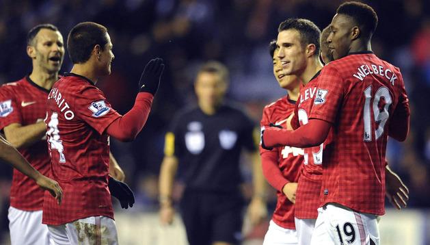 Los jugadores del Manchester celebran uno de los goles marcados al Wigan