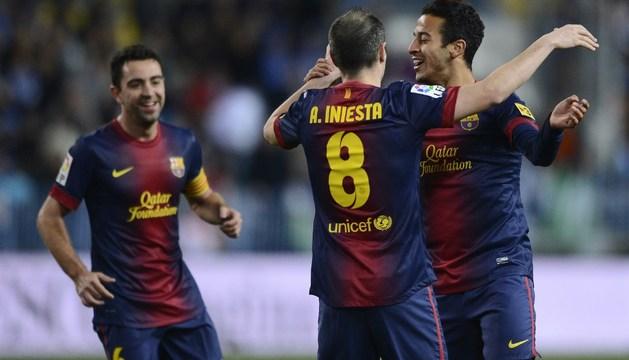 Xavi, Iniesta y Thiago