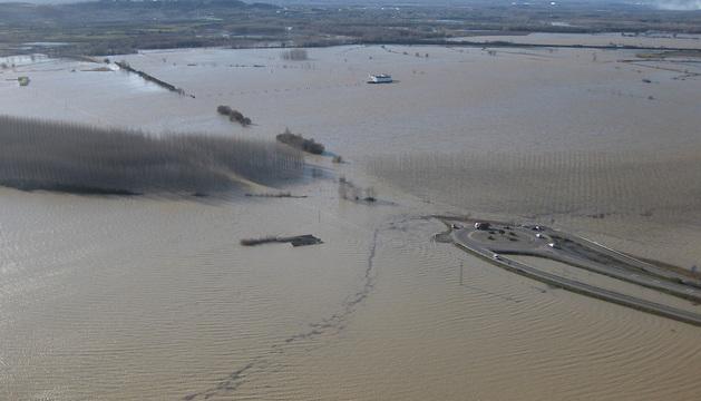 Una granja afectada por las inundaciones en la Ribera.