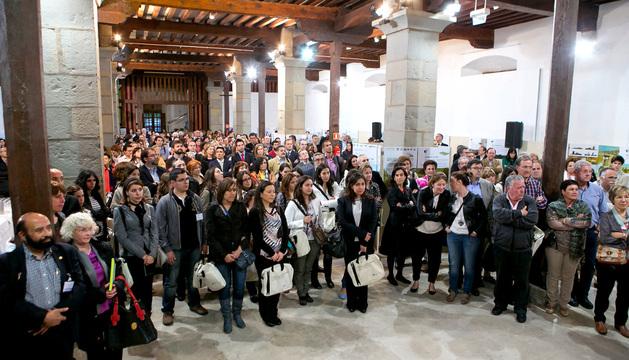 Los asistentes al congreso escuchan el discurso de Enrique Maya