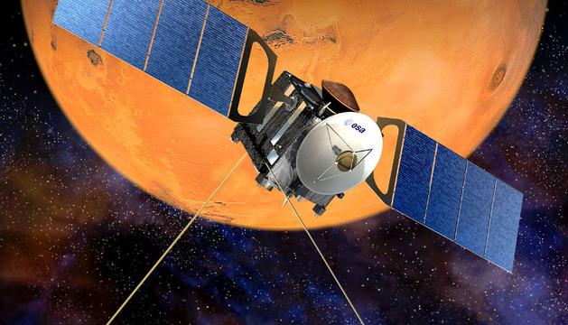 Montaje facilitado por la Agencia Espacial Europea que muestra a la sonda Mars Express sobre Marte