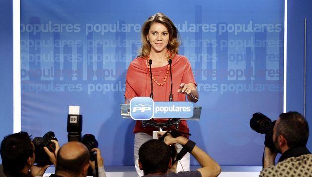 a secretaria general del PP, María Dolores de Cospedal.