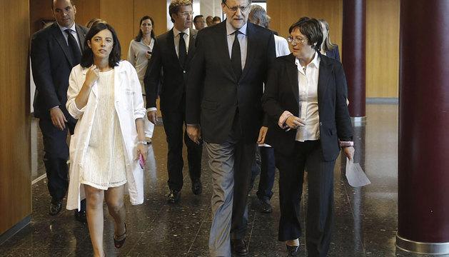Rajoy, seguido del presidente gallego, Alberto Núñez Feijóo.