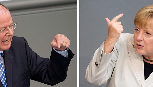 Merkel y Steinbrück.