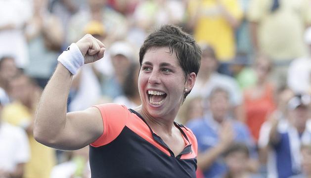 La española Carla Suarez Navarro celebra su pase a cuartos de final en el Abierto de Estados Unidos.