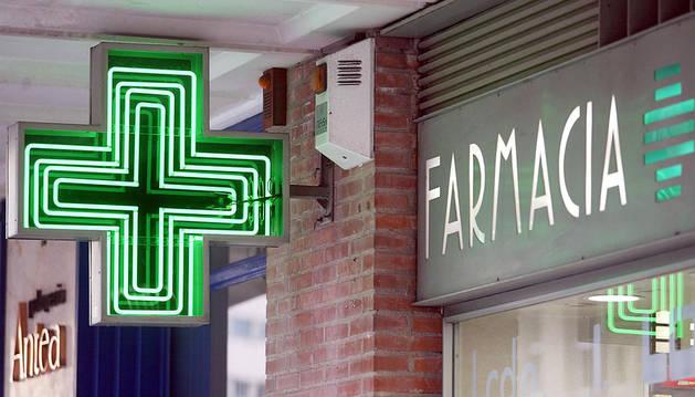 Imagen de la cruz que identifica a las farmacias
