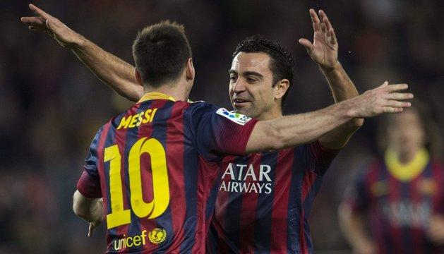 Xavi y Messi