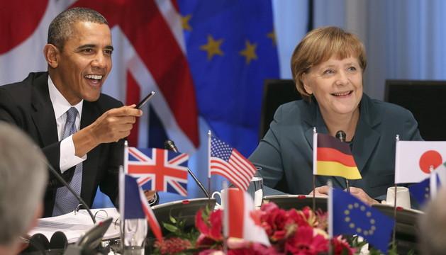 Barack Obama y Angela Merkel, asisten a una reunión del G-7 el pasado lunes