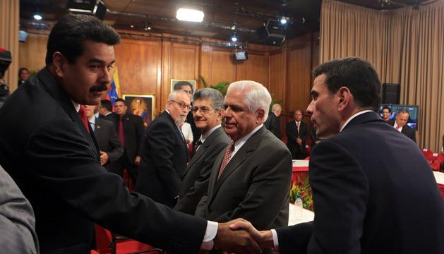 El presidente, Nicolás Maduro, y el jefe de la oposición, Henrique Capriles.