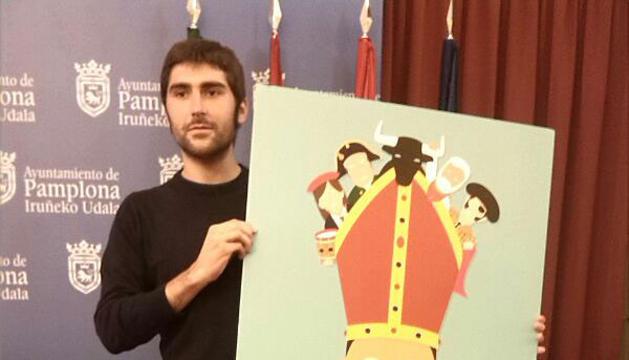 El autor, Ignacio Doménech Payá, junto al cartel ganador.