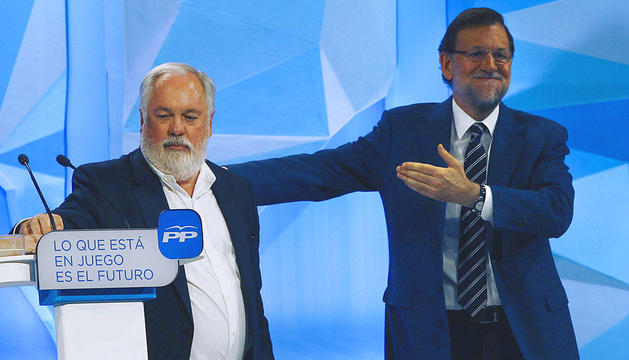 Rajoy, junto a Arias Cañete en Barcelona.