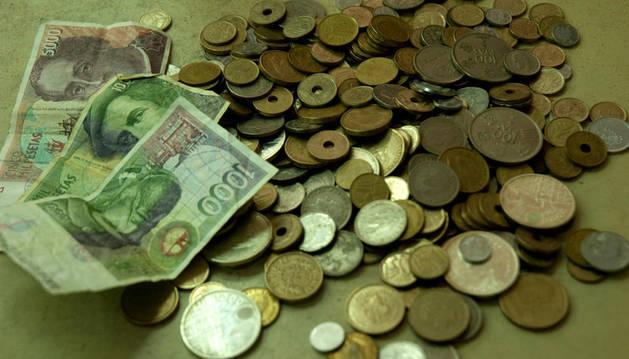 Billetes y monedas de las antiguas pesetas
