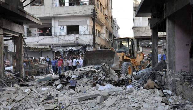 Daños producidos por un atentado del Frente al Nusra en Homs
