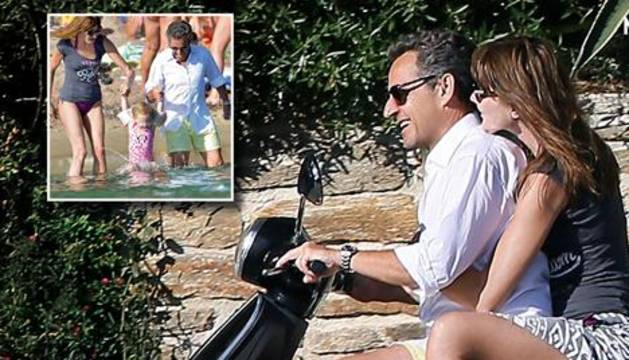 Sarkozy y Bruni, en motocicleta y sin casco