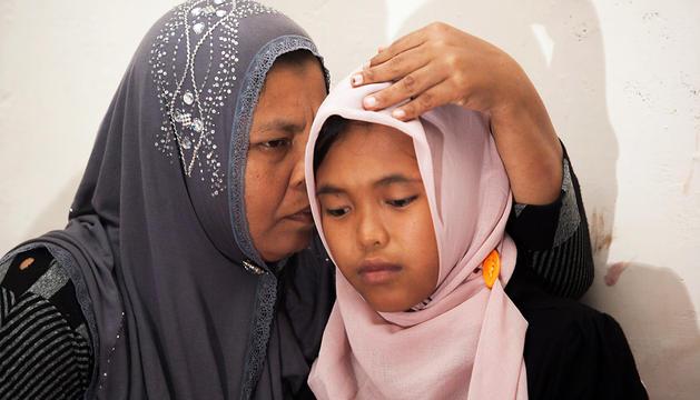 La madre abraza a su hija 10 años después del tsunami que se la arrebató