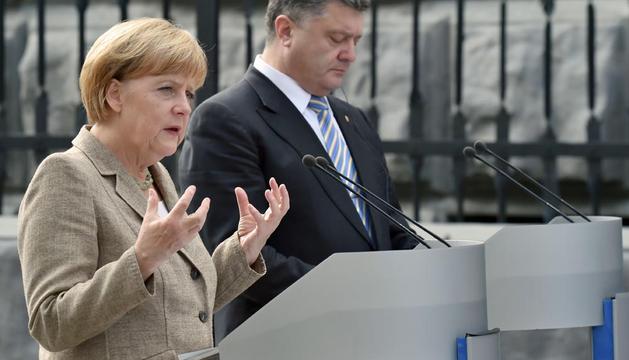 Angela Merkel y Petro Poroshenko, en su comparecencia pública en Kiev