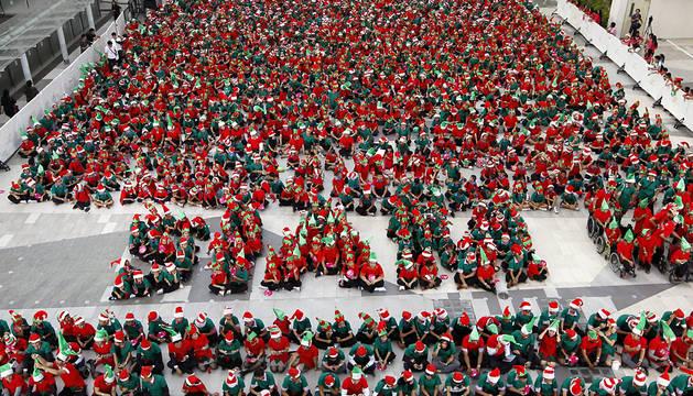 Los 1.762 niños vestidos de elfos de Papá Noel.