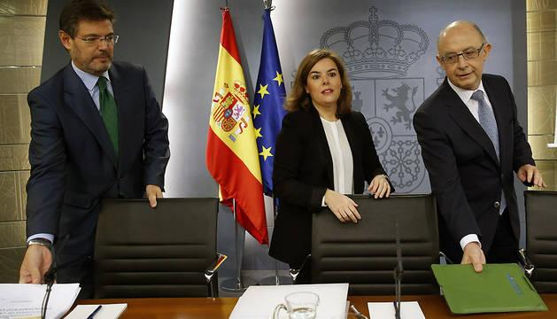 Rafael Catalá, Soraya Sáenz de Santamaría y Cristóbal Montoro, este viernes