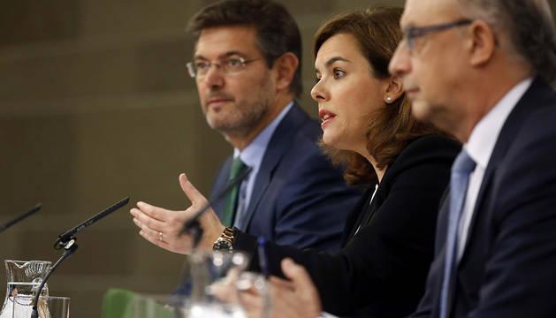Soraya Sáenz de Santamaría, y los ministros Rafael Catalá y Cristóbal Montoro.