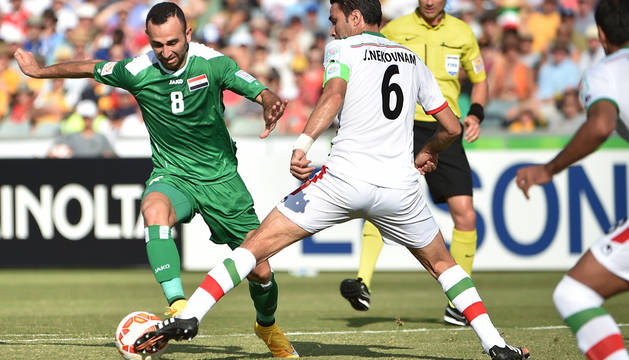 Nekounam, durante el partido ante Irak.